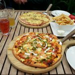 Tasty pizzas and hot crispy chips