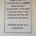 Notice on bathroom door