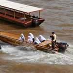 Local people taking water taxi service