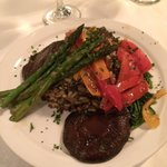 Grilled portobello mushroom with wild grains and grilled asparagus.