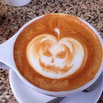 Salted Carmel Latte with a pumpkin floated on top!
