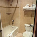 Clean bathroom with shower/tub; Aveda toiletries