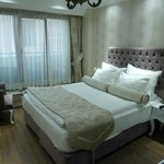 Clean and comfortable bedroom, furnished in indiviual style