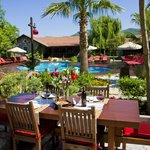 Our restaurant overlooks the beautiful pool and gardens