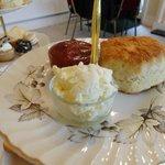 warm scone and cream and jam