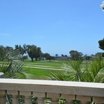 View of the golf course and ocean from the pool area.