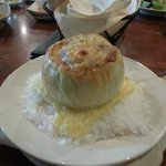 French onion soup in onion bowl and held in place with rock salt. Great presentation