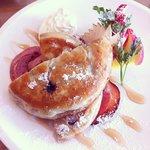 blueberry pancake with crispy bacon and seasonal fruits