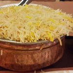 Biryani served with raita and Mirch ka salan