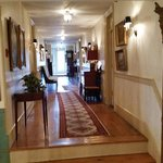 Upstairs hallway. Pale wood floors and rugs