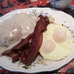 biscuits and gravy platter with potatoes, eggs, and bacon!