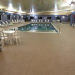5 foot indoor pool and there is a hot tub also in the corner. Pool area has bathroom and showers