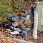 Garbage behind electrical box