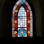 Stain glass windows bring colors to the interior