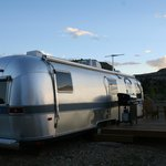 One of the Airstream trailers they rent with BBQ, chairs, deck