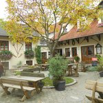 Gorgeous outdoor seating under the chestnut tree in Farm courtyard