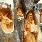 carved wooden statue in their courtyard