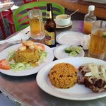 Our food!! Shrimp Mofongo & fried pork chop with rice and beans !
