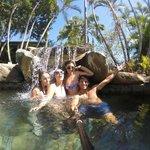 playing in the pool waterfall
