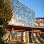 Another view of the entrance, with a gorgeous sunset reflected in the glass. Inside, there is pl