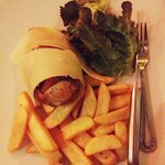 Bacon-wrapped chicken breast stuffed with sundried tomatoes. Usually served with pasta, staff we