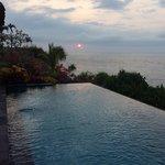 sunset across infinity pool