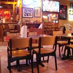 """Inside Seating At Fish N"""" Tails Oyster Bar"""