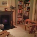 The beautifully cosy living room complete with log burner