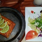 Salmon al carbon with salad, baked potato and arepa