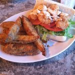 Shrimp poboy w/ potato wedges (3/5 for this order)