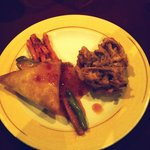 Samosa with flavored vegetables and onion rings