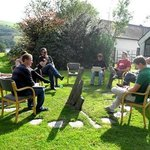Writers' critique session around the sundial. Sept 2014