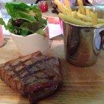 8oz fillet steak.  Rare.  Peppercorn sauce. Fries.  Mixed greens.  Tomato garlic thyme.  Mushroo