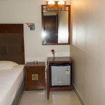 Bed room mirror and fridge @ room no 206 Akshay INN
