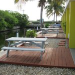 Outdoor decks & tables of waterfront rooms on canal.