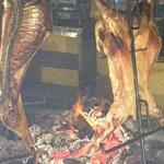 Roasting lamb at front of restaurant