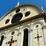 Detail of the upper facade of Santa Maria dei Miracoli with its multi-colored marble
