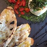 outstanding burrata appetizer with basil pesto & heirloom tomatoes!