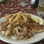 """Tilapia with """"Texas toothpicks, """" breaded and fried strips of onion and jalapeño, as well as fri"""