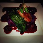 Duck breast with spinach and sweet potato (camote) in blackberry sauce.