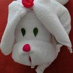 Cute towel animal wearing flowers from hotel garden