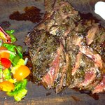An excellent salad with a cold and tasteless steak that had to be warmed