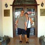 My parents at the entrance of the residence