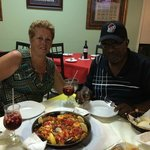 My sister and brother in law, digging into the Paella