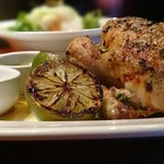 Whole grilled chicken with salad & sauces.