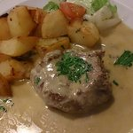 Fillet steak with cheese sauce and potatoe and salad side.