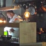 Cooking by lantern light. A very dedicated chef!