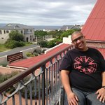 My hubby who wheelchair bound enjoying the balcony at the guest house