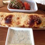 Lamb kebab with onion, cheese, pepper in soft roll