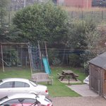 Play area and picnic/bbq garden area off car park at back